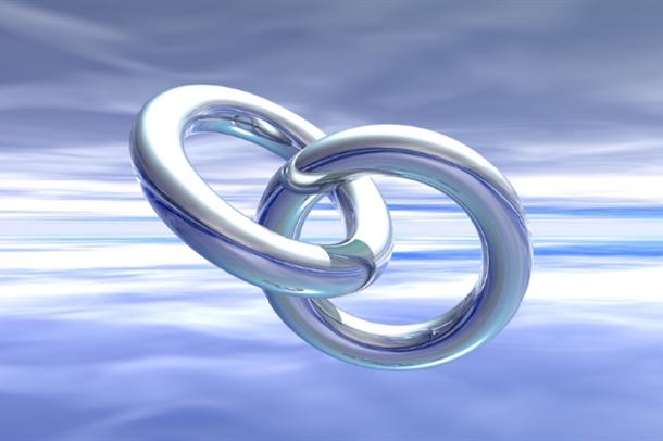 Illustrasjon av to ringer som er lenket sammen i en kjede.